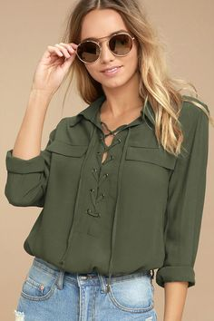 The Once in a Lifetime Olive Green Lace-Up Top has that unique, trendy style we've been looking for! A collared, lace-up neckline tops this woven blouse with decorative flap pockets and a notched high-low hem. Long sleeves with button cuffs.