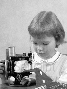 This is a postcard from the 1960's. I wonder how many children started their sewing lives on a Singer 20 sewing machine?