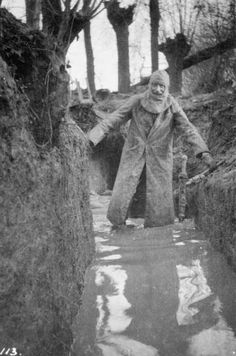 Once Upon a Time in War: Colonel Philips R. Robertson making his way through flooded trenches at Bois Grenier after toruing his unit's positions/1915