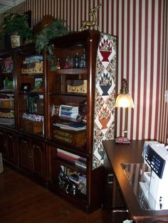 Love the skinny quilt on the bookcase!