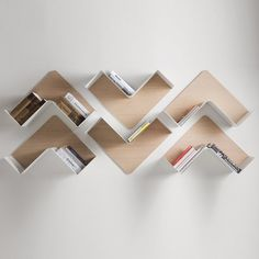 Fishbone is a modular shelf resembling herring fish bones that can be arranged in a variety of ways. The back panel is made of multi-layered plywood while the shelving surface is made from extremely thin curved sheet-metal. Fishbone can be arranged at 45 or 90 degrees, in pairs or in multiple combinations in order to decorate your walls with practicality.