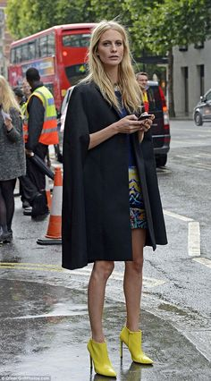 Poppy in a black cape & bright yellow boots #StreetStyle