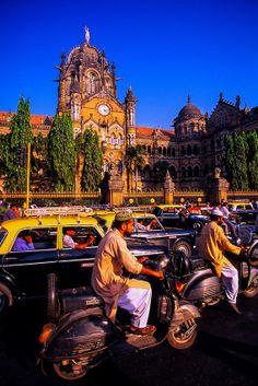 Street traffic in front of Victoria Terminus, Mumbai, Maharashtra, India