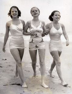 Warner Bros. young stars in training, Carol Hughes (1910-1995), Marie Wilson (1916-1972) and June Travis (1914-2008) take a walk on the shore in this studio publicity photograph. Although they never all appeared together in a film, Warner Bros. had high hopes for each of the starlets in the 1930′s and set up this photograph to showcase their assets.