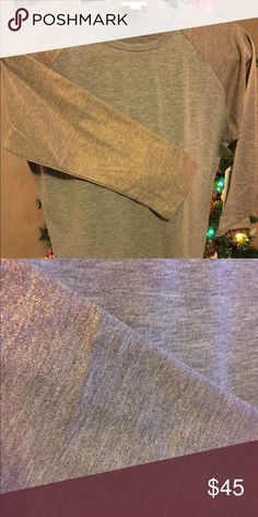 LuLaRoe Elegant Randy Gold Metallic Sleeves NWT Sm NWT! Elegant Collection Randy from LuLaRoe..... The color on these sleeves is extremely hard to capture in photos. Metallic gold/rose gold sleeves & simply gorgeous! Shiny but subtle & amazing. One only! Perfect for everyday wear but able to be dressed up too! LuLaRoe Tops Tees - Long Sleeve