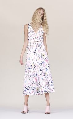 Try the midi-length trend with the Sleeveless Tapestry Garden Ruffle Dress in a floral print with ruffle detailing