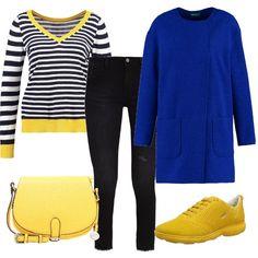 Bianco e nero sono illuminati in questo outfit dal giallo limone presente nella maglia, nelle scarpe e nella borsa. Tutti insieme trovano un ulteriore elemento di caratterizzazione nella sovrapposizione al blu elettrico che li vivacizza e li fa risaltare.