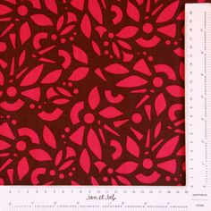 Preciosa tela de algodón en tonos rosas y marrones con motivos geométricos para combinar con cualquier tela.
