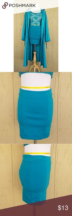 Ambiance Apparel Mini Skirt Ambiance Apparel bodycon mini skirt features an exposed back zipper closure and 2 back pockets.  📐DIMENSIONS📐 (approximate) ⚠COMING SOON⚠  75% Polyester 20% Rayon 5%   Spandex  Color(s): Turquoise Skirts Mini