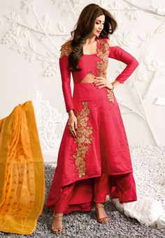 This Art Silk Aline #Suit with high-low #layers is so remarkably #unique, that you'll crave to own it. Don't you love that dominant #golden #Zari, Dori, #Stone & Applique #floral #embroidery on this #Fuchsia piece? Picture Code: KCH392
