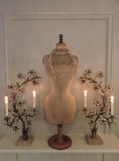 Beautiful vignette wit dress form and candelabras