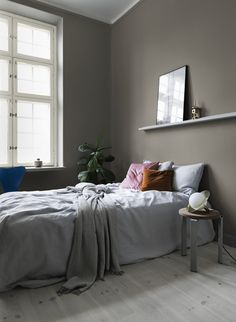 Warm gray shades pulling red or yellow, creating a cozy feeling in the bedroom. Wall painted in Pigeon Grey and windows in Äggskal from Alcro Closet Bedroom, Master Bedroom, Bedroom Decor, Bedroom Wall, Home Interior, Interior Design, Feminine Bedroom, Wood Pendant Light, Woman Bedroom