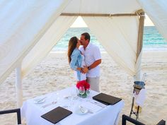 Proposal in Turks and Caicos at sunset on the beach in a tent with dinner and wine by ourselves Amazing!!!
