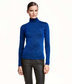 Long-sleeved, fitted top in jersey with glittery threads. Stand-up collar. Concealed zip at back of neck.