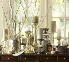 Mercury glass paired with glittery candles and snowy branches are the perfect addition for icy Christmas decor.