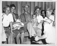 """Part of Social Hour audience at Shafter Camp (handwritten on reverse); b) Todd's favorite picture of an """"Okie Family"""" in Shafter F.S.A. Camp. Nursing babies was the usual thing at camp """"Socials.LOC Photo Display"""