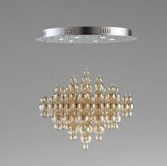 This enchanting chandelier/pendant will illuminate your ceiling with smoky glass bubbles that are delicate and sophisticated. Give your dining room or kitchen an ethereal and romantic ambiance with th