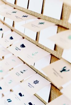 Nautical escort cards by Scout Designs mounted on a burlap board