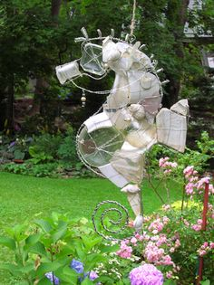 love this seahorse by Lynette Walther ~ her sculptural pieces are composed of found objects from the coast of Maine that include frosted seaglass, vintage china fragments, sea shells and assorted oddities.