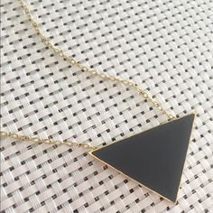 "Black Triangle Necklace  Black Acrylic Triangle Fashion Necklace • Gold color chain • Lobster clasp • 16"" with 2"" extender • Triangle measures approximately 2"" x 1.5""  Jewelry Necklaces"