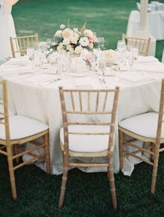 love the chairs - I like how the centerpiece is a low floral arrangement so the guests at the table can still talk to and see each other