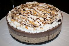 Best Mud Pie recipe you'll ever see. OREO cookie crust, coffee ice cream center, and chocolate mousse topping with hot fudge, caramel, and crunch on top. YUMMY!