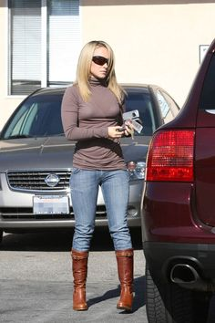 Cute boots, hair, and love the turtleneck.