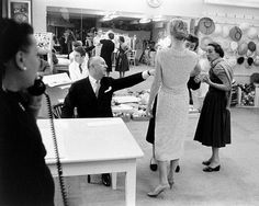 Christian Dior designing in his salon. Photographed by Loomis Dean. LIFE photo archive.