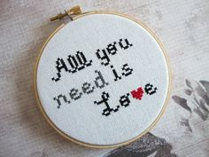 Completed All You Need is Love Cross Stitched in Embroidery Hoop. $30.00, via Etsy.