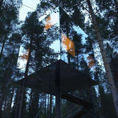 Tree Hotel by Tham & Videgård Arkitekter.  The 4x4x4 metre cube is accessed by rope bridge and reflects the surrounding forest and sky.