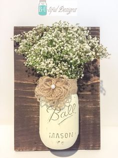 A personal favorite from my Etsy shop https://www.etsy.com/listing/224018563/burlap-mason-jar-wall-decor-hanger