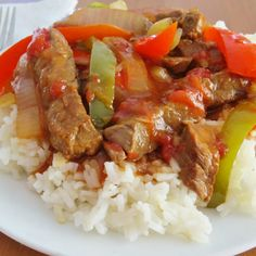 Crock Pot Pepper steak is made with tender beef strips, peppers, onion and a tomato based sauce. It couldn't be easier and the flavor is amazing!