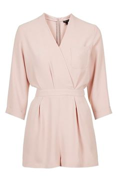An elegant wrap front creates a sophisticated deep neckline on a versatile, long-sleeve romper that makes for simple summertime dressing.