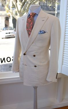 Double breasted linen suit with patch pockets.