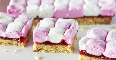 This great looking dessert combines soft marshmallows with coconut and jam.