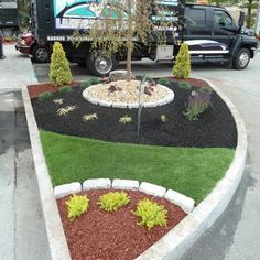 This photo was taken at a Honey Dew Donuts Design job we contractedusin Synthetic Grass, Rubber Mulch & Exotic stones | Yelp