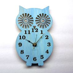 Wall Clock  Modern Wooden Owl Silhouette Home Decor  with Sky Blue  Finish. $39.99, via Etsy.