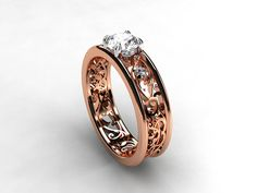 Rose gold filigree engagement ring with 0.50ct diamond in white gold setting by TorkkeliJewellery, $4490.00