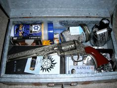"""""""Supernatural Hunter Kit I put together from my brother for X-mas. Old Bible, Winchester brand knife, phoenix ash, matches (I decorated matchboxes) & lighters, kosher salt, a temporary tat (like the boys have from tvmerch), flashlight, 67 Impala cologne oil (Etsy), Colt replica, Zep cassette tape (with Dean's favorite song), road atlas, occult book, printed exorcism chant in Latin, and homemade badges with actual aliases/departments used on the show since season one."""" ~ I so want to do this!!!"""