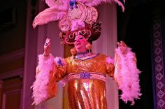 Richard Aucott as Pantomime Dame Widow Twankey showing off her new found money in Aladdin performed at Sutton Coldfield Town Hall January 2014