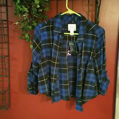 Cropped flannel shirt Blue and black cropped flannel shirt, brand new. Forever 21 Tops Crop Tops