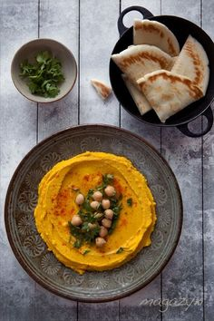 Pumpkin Hummus 3/4 cup chickpeas, cooked or canned 2 tablespoons tahini 1 clove garlic, chopped 1 tablespoon olive oil + some for of splashing 1 tablespoon lemon juice or to taste 3/4 cup pumpkin puree 1/4 teaspoon sea salt or to taste parsley, coarsely chopped pinch or two of paprika
