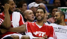Tim Duncan shares a laugh.  (USATSI)