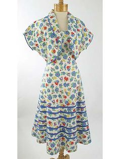 Pinning for the piping, pattern and colors.  50s Floral Cotton Sundress Bolero Jacket Set