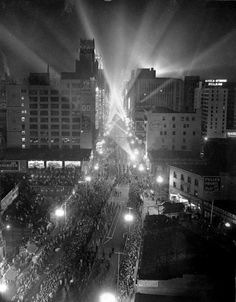 (1936)* - Tens of thousands of people jammed the parade route on Broadway on the night of October 9, 1936, as the street became ablaze with ...