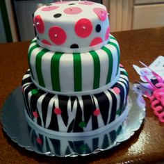 I used Wilton sugar sheets on top of fondant for this cake