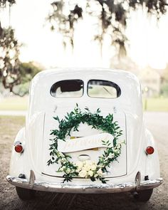 You can never go wrong with a classic getaway car! | Photography: @perryvaile | Cinematography: @h2hmedia | Event Planning + Design: @arhodesevents | Floral Design: @emcreativefloral | Banner: @simplyjessicamarie