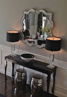 Simple entrance table. Mirror, two lamps and a bowl for keys. Little more rustic than this.