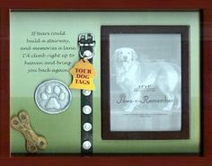 Create a shadow box with some of your beloved pet's favorite toys, paw print, or collar along with a photo.