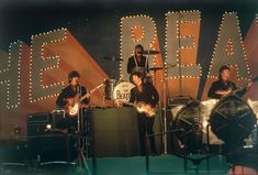 The Beatles perform at Budokan Hall in Tokyo, Japan for the first time, June 30, 1966. Front, from left: George Harrison, Paul McCartney and John Lennon. Behind on drums is Ringo Starr. (AP Photo)
